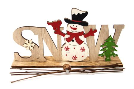 Christmas wooden decoration with a snowman and the inscription SNOW. Christmas and New Year accessory for home decoration. The concept of the New Year holidays and decor.