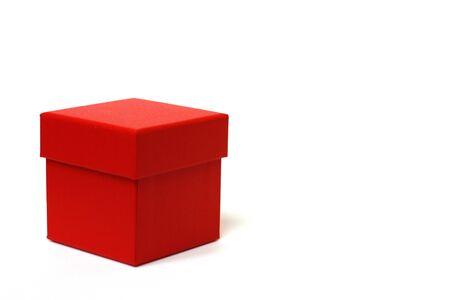 Red gift box with a lid on a white background. There is a place for text. Bright red box without inscriptions.
