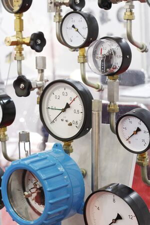 Manometers showing technical. Measurement of excess pressure in the pipelines of housing communications systems. Pressure gauge design. Many different manometers in one photo.