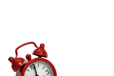 Red watch on a white background. Red vintage alarm clock on a white background. Only a part of the hours is shown. The concept of running away time.