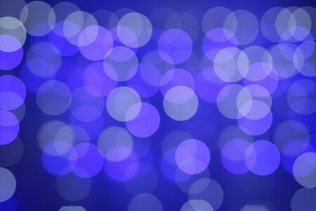 Abstract circular bokeh. Christmas lights. Colorful circles of light abstract background. Elegant grunge. Blue bokeh abstract background. Background for social networks.