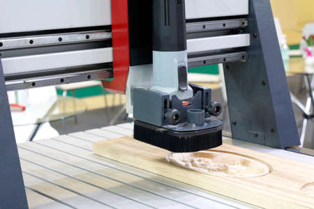Milling a wooden board. Processing of wood panels on CNC coordinate milling woodworking machines. CNC woodworking machine.