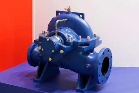 Detail of an electric high pressure centrifugal pump for industry. Sectional turbopump installation. Electric pump unit.