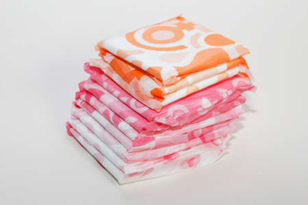Sanitary napkin for women during menstruation. Critical days. Menstrual pad for women for hygiene or blood period. Personal hygiene protection for women. Standard-Bild