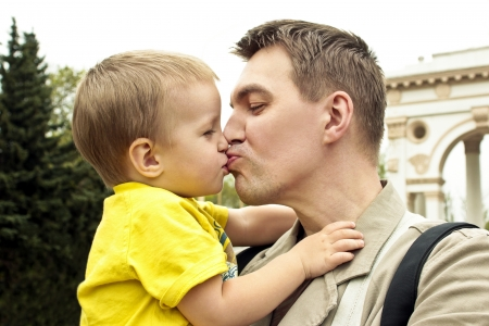 Man kisses and hugs baby  photo