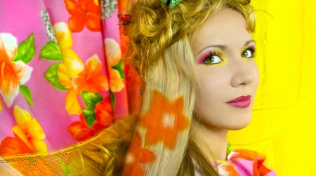 streaking: Young girl with pink and yellow makeup and hair colouring in the shape of flowers.