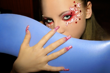 rhinestones:    On girl eye makeup matches the pattern on your nails