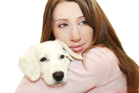 Young, beautiful girl hugging white puppy  photo