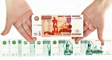 roubles: The Russians large bills in the hands of a man on a white background  Stock Photo