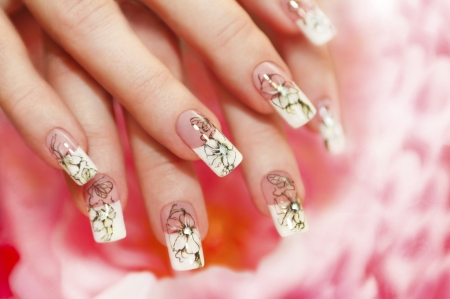 Floral French manicure on the pink white background