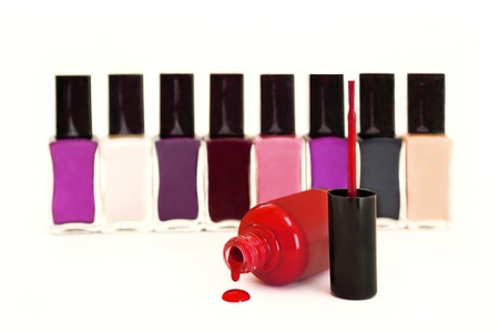 The collection of multi-colored nail Polish on a white background. Stock Photo