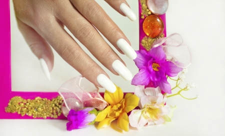 Beautiful white manicure on a gray background with pink flower frame