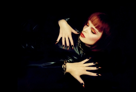 hair part: A beautiful young girl with orange hair,red lips and long nails