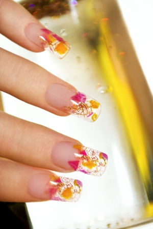 Aquarium design on transparent nails shiny threads and small multi-colored pieces of yellow and pink acrylic  photo