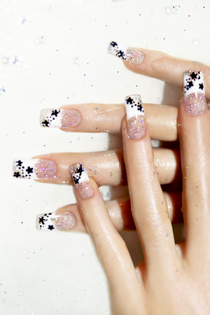 acryl: Aquarium design on transparent nails with black stars inside acrylic and sparkles in the water