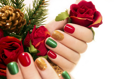 Beautiful multicolored manicure on a white background