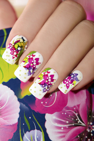 nails art: Beautiful drawing of colors on a white lacquer with green beads