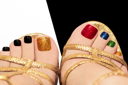 Multicolored shining pedicure on white or black background  Stock Photo