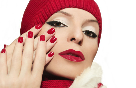 Beautiful girl with red lips and fingernails on a white background  photo
