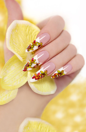 long nail: French long nail picture of orchids in the woman s hand