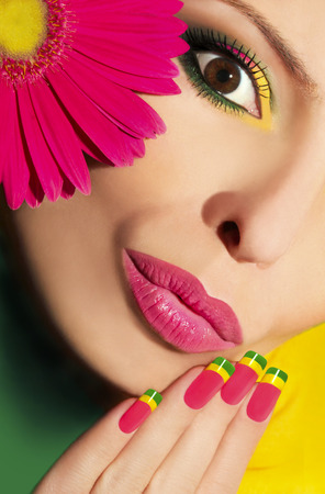 Colorful makeup and nails with gerberas  photo
