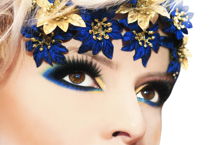 Blue makeup on the eyes of brown color with flowers  photo