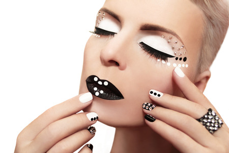 rhinestones: Makeup with rhinestones and manicure in black and white colors on the girl  Stock Photo