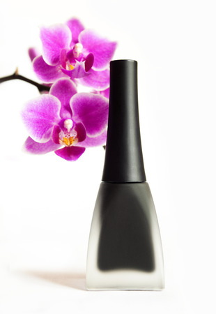 nursing bottle:     Black matte nail Polish with Orchid on a white   Stock Photo