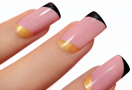 Fashion nails on artificial nails with pink, yellow and black lacquer on a white background  Stock Photo