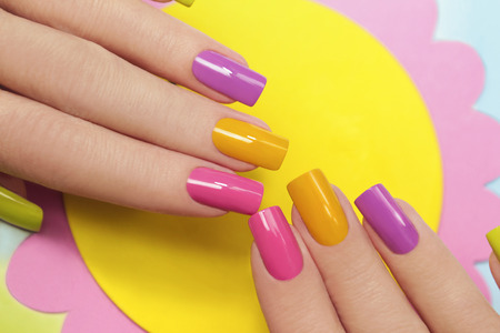 Solar manicure colored varnishes rectangular shaped nails.