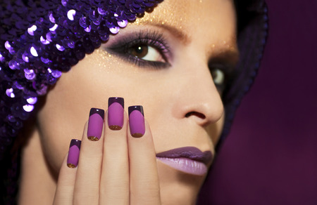 Purple French manicure and makeup on the girl with the different purple violet hues.