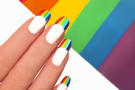 french manicure: French manicure with bright colored stripes on the background.