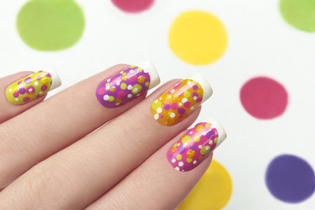 Nail design: French manicure with points on different color nails.