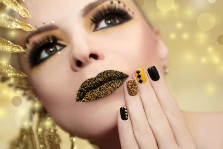 Caviar manicure and lips.