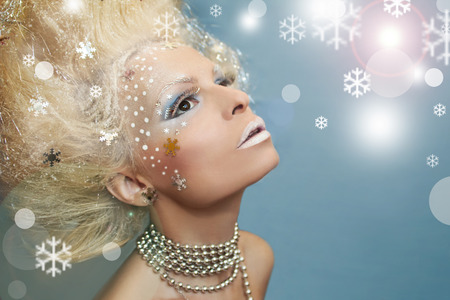 Snow magic image of a girl with blond hair. Archivio Fotografico