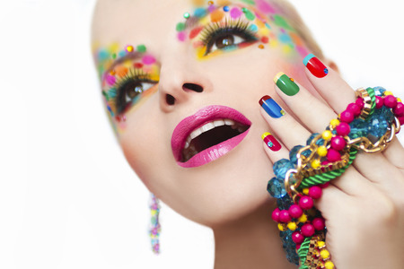 french manicure: Colorful French manicure and makeup on the girl with rhinestones.