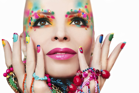 bracelets: Colorful makeup and manicure with ornaments of different shapes and colors on the blonde girl. Stock Photo