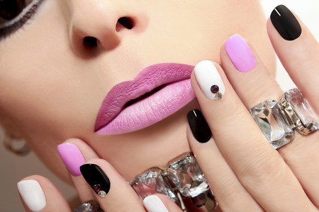 pink nail polish: Fashion nails with rhinestones and colored nail Polish.