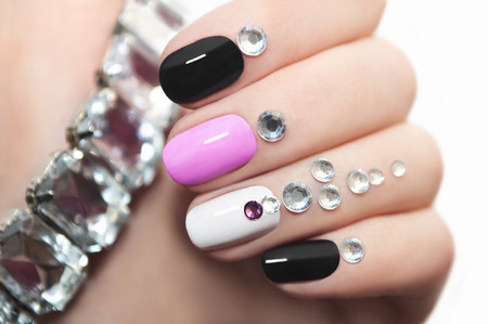 pink nail polish: Colorful manicure oval shape nails with rhinestones.