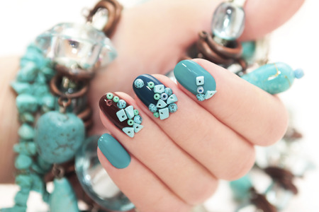 human fingernail: Manicure with stones of turquoise.