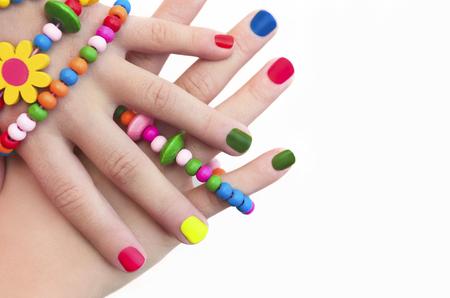 Colorful children's manicure c decorations on hand. Standard-Bild