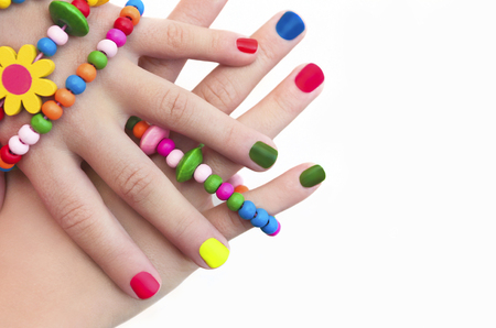 colorful: Colorful childrens manicure c decorations on hand. Stock Photo