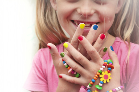 pink nail polish: Childrens multicolored manicure with ornaments on a hand. Stock Photo