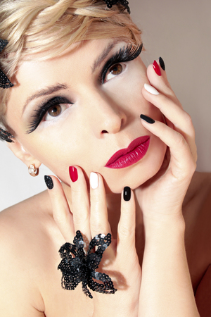 black makeup: Makeup and manicure with red nail Polish and lipstick. Stock Photo