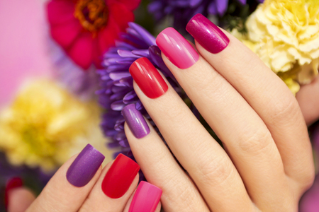 polish: Manicure covered with nail Polish in the colors of nature. Stock Photo