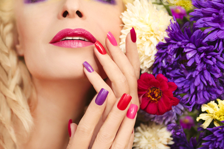 Colorful makeup and manicure with summer flowers asters.