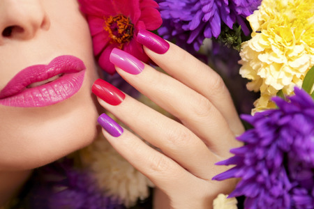 artificial nails: Colorful makeup and manicure with summer flowers asters.