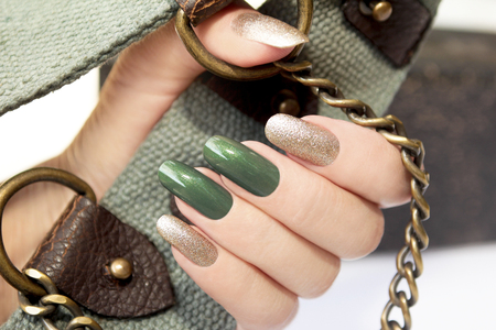Green silver manicure with a belt in his hand.