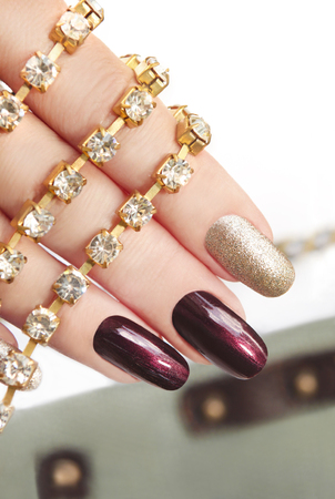 art design: Brown silver manicure with rhinestones on the arm. Stock Photo