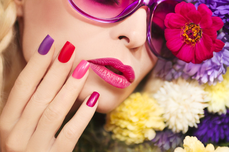 beautiful eye: Colorful makeup and manicure with summer flowers asters.